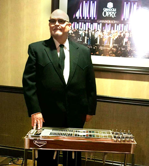 Johnny Cox with his restored Emmons steel guitar